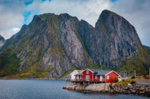 Red house with mountain view on the background - Reine