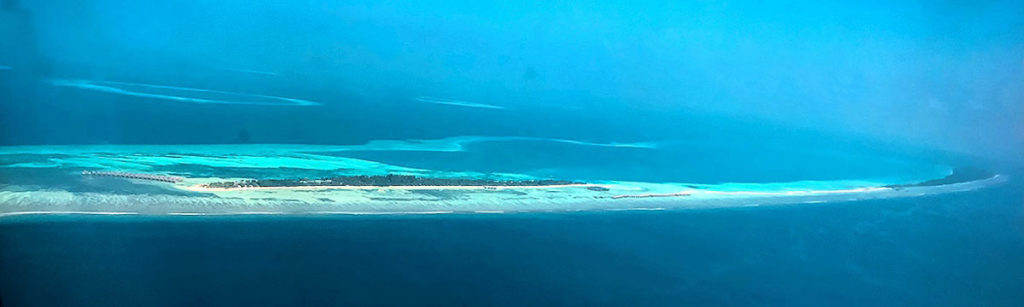 View of an island from the plane - Maldives