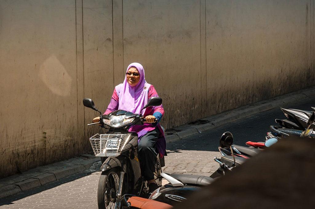 Woman on a motorbike - Maldives