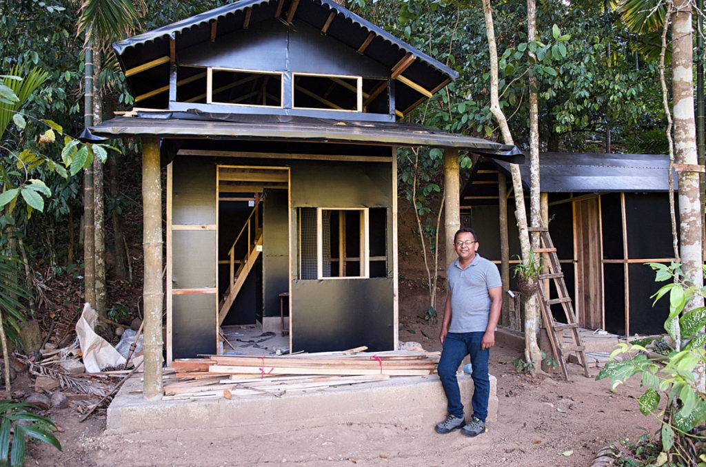 Roshan in front of an unfinished house - Kandy