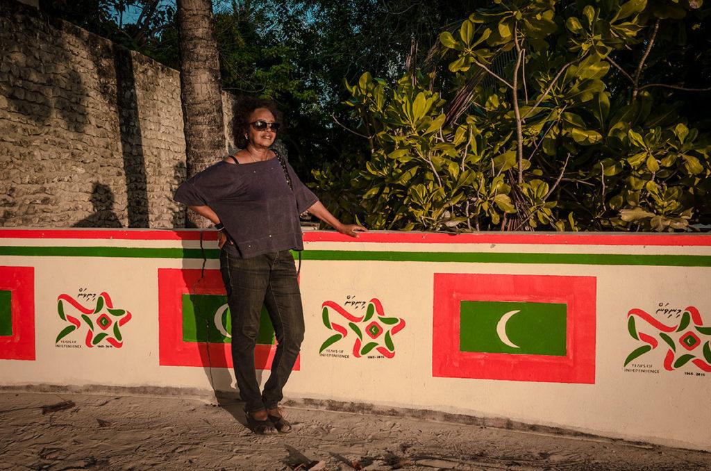 Khadija by a commemorative wall - Dhigurah