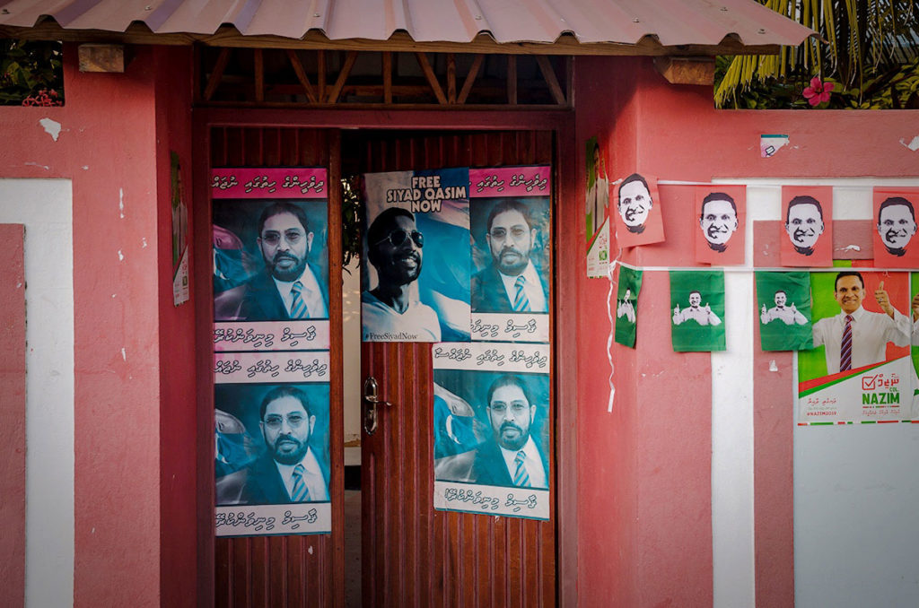 Elections posters on a wall - Dhigurah