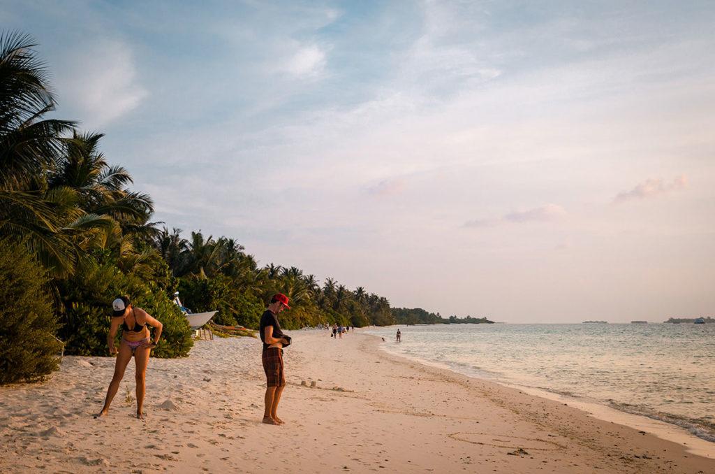 Tourist on a long beach - Dhigurah