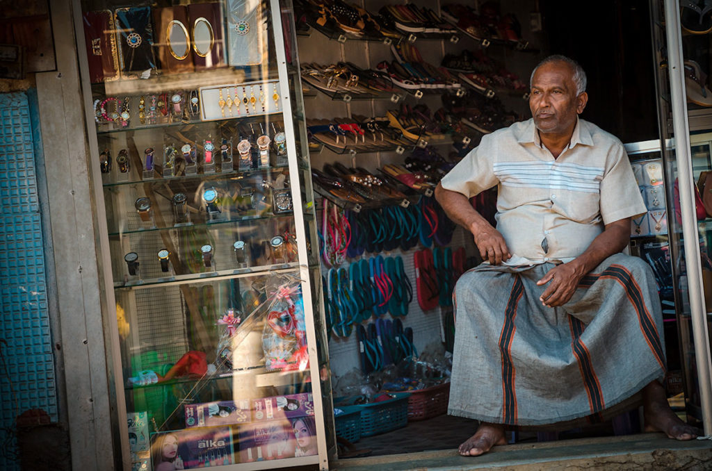 Local merchant in his shop - Kandy
