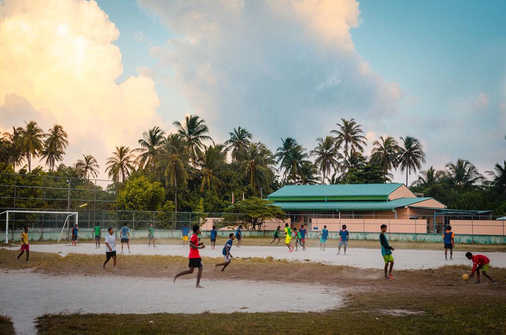Boys playing soccer - Maldives