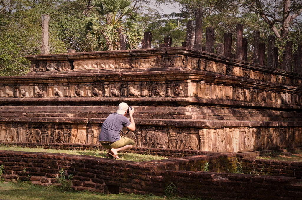 Peter taking pictures of animal carvings - Pollonnaruwa