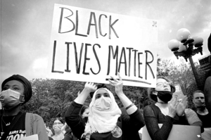 Woman in Hijab with Black Lives Matter Sign