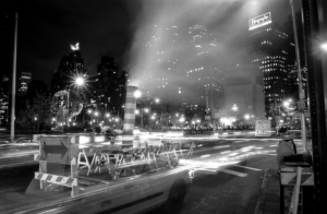Ghost-like taxi passing by Columbus Circle at night