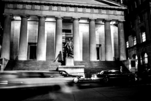 Cars passing in front of the Federal Hall at Night