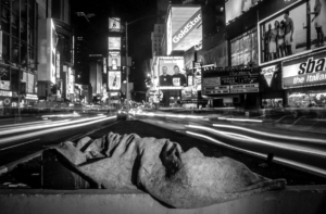 Homeless man sleeping in the middle of Times Square
