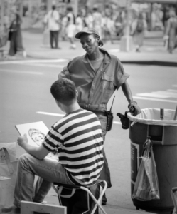 Times Square Street cleaning lady having portrait drawn